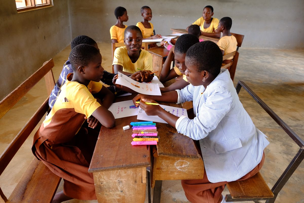 African girls at a table learning
