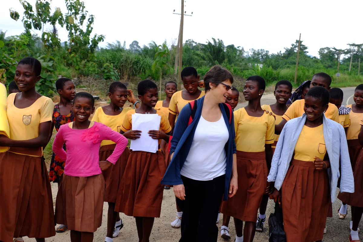 AEC walking with students in Ghana.