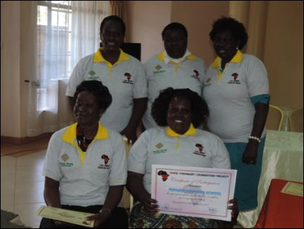 Magadi Teachers holding their school certificate for participation