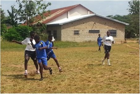 The WHW Girls' Club playing a football match.