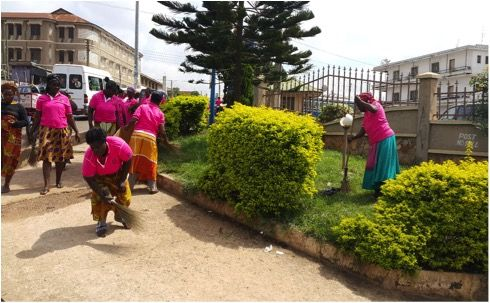 Women earning SoCCs while cleaning the Bantama Market in Ghana