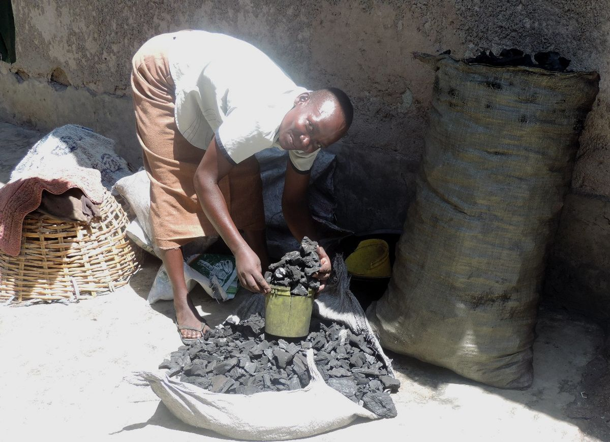 After joining a Group Savings & Loan, her cooking charcoal business took off.