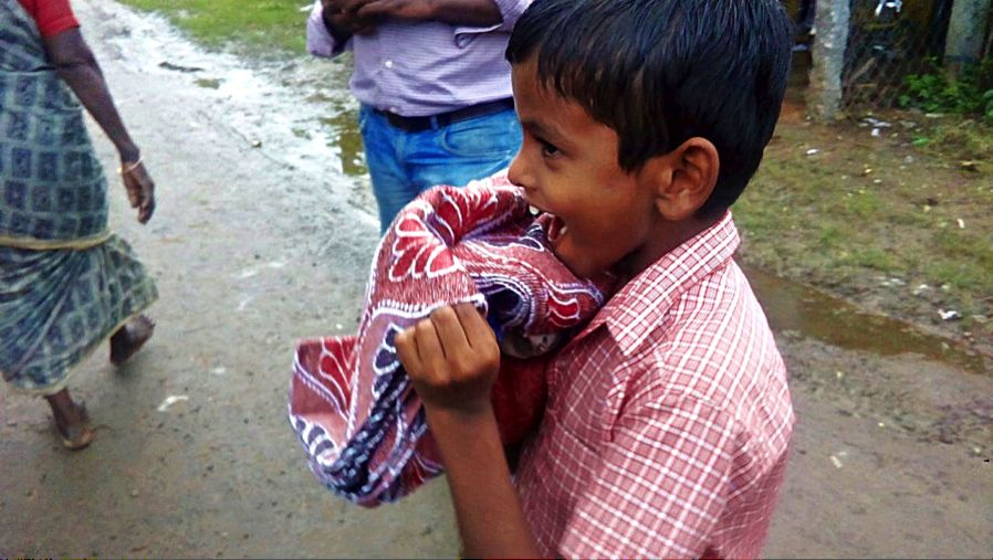 Young child given blanket post flood
