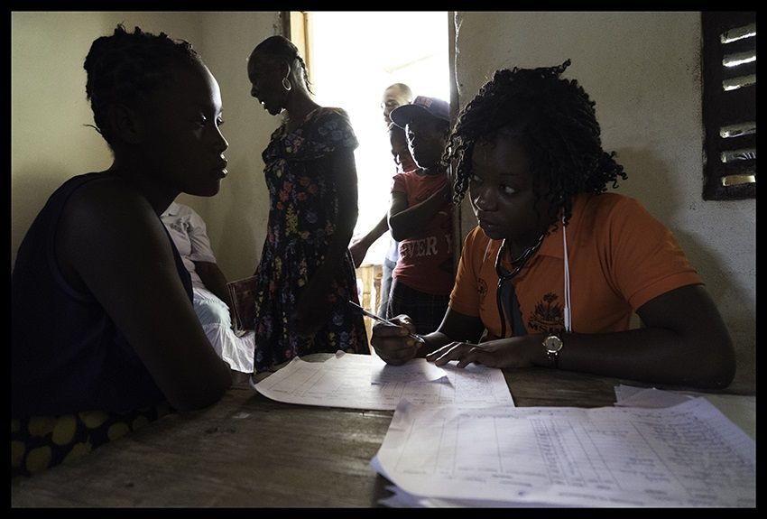 Checking in patient, taking history at women's mobile clinic in Sante Nan Lakou