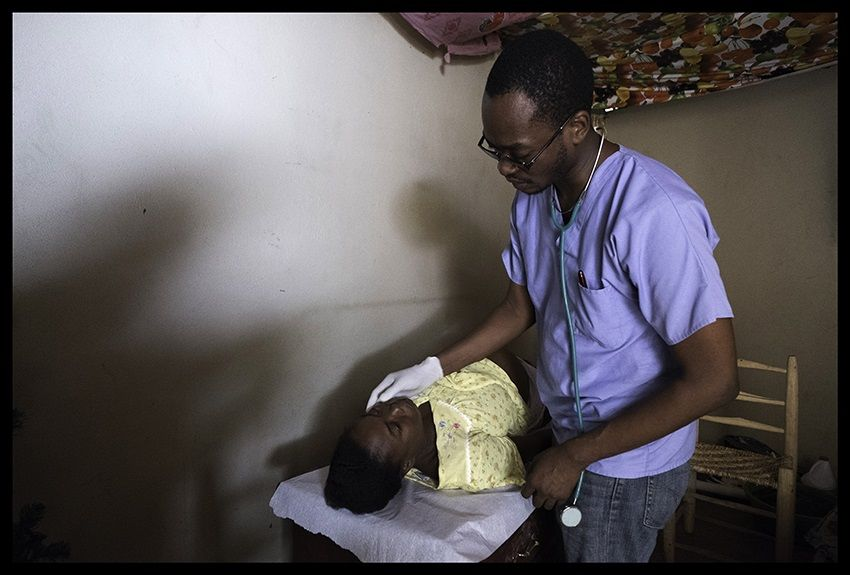 Dr. Herlandy Princivil exams a pregnant patient at a mobile women's clinic in late March 2016