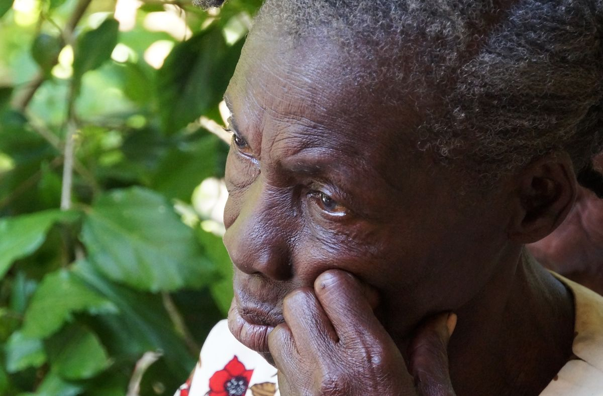 Older woman waiting outside mobile women's clinic to be seen by a doctor.