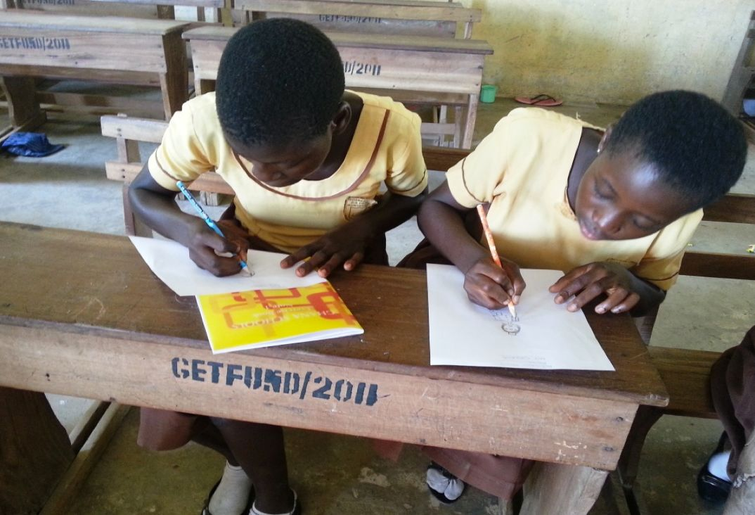 Girls busily engaged in a drawing activity during a Club