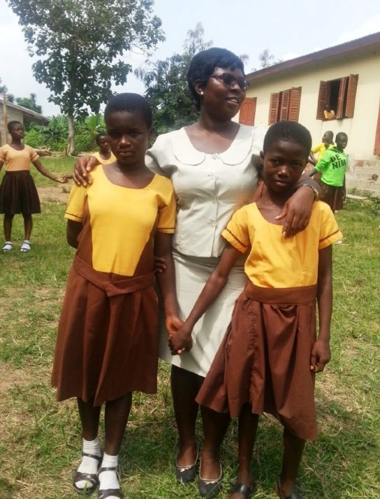 A Club facilitator with two girls