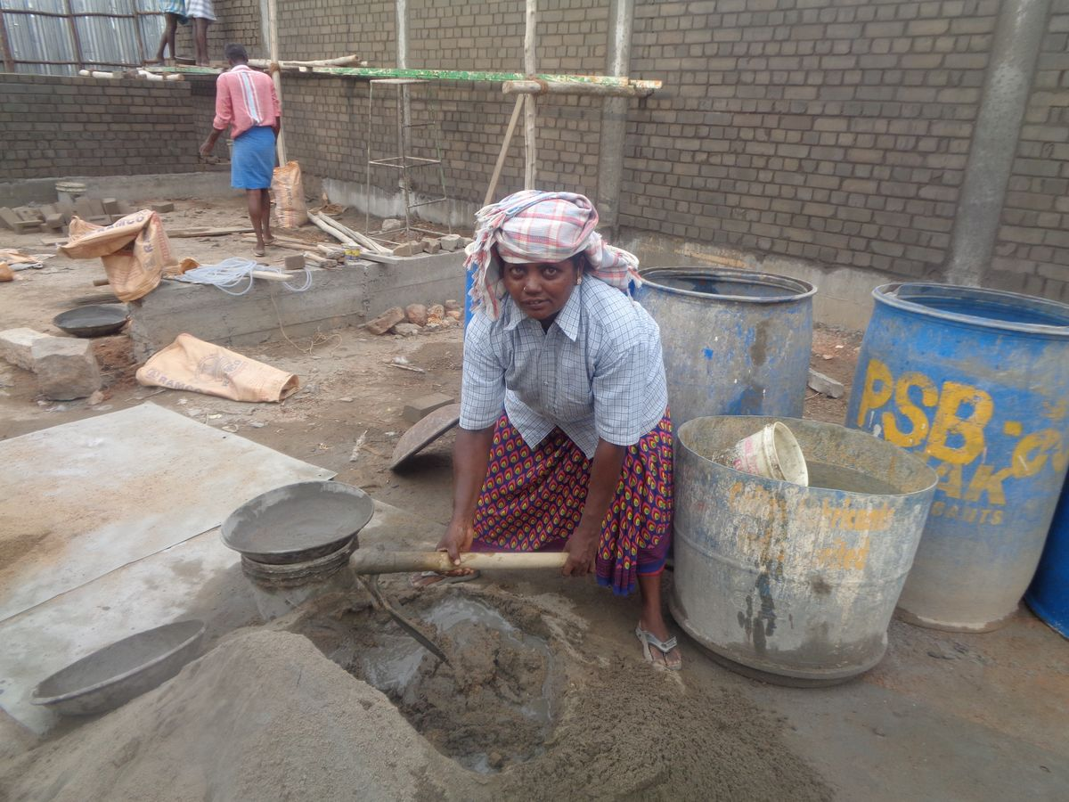 Muthulakshmi working at the job site