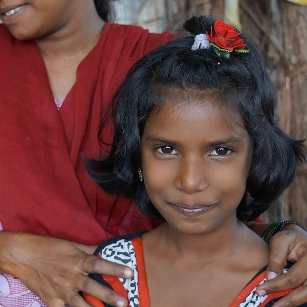 Young girl with mother.
