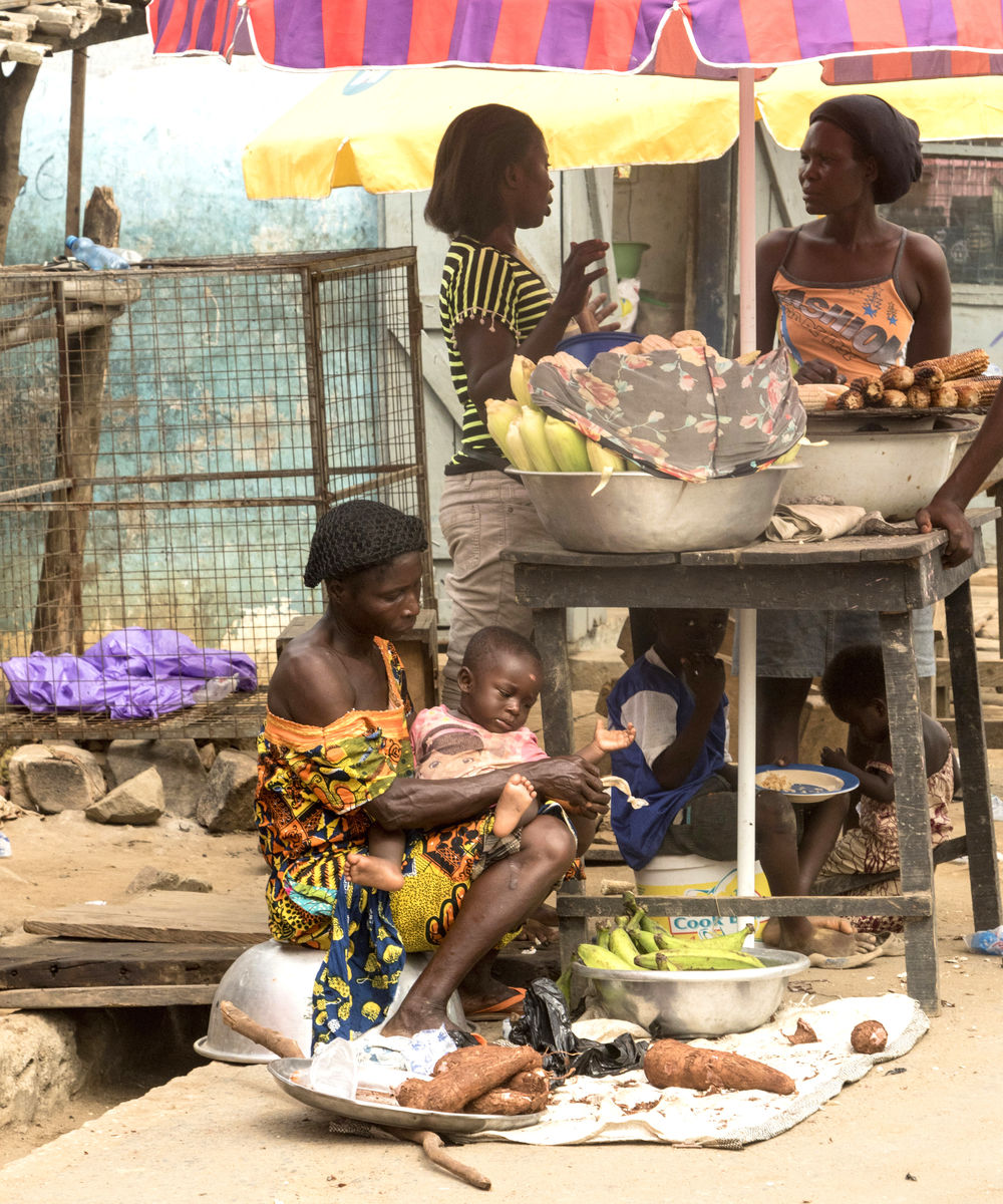 Girls working at a market in Ghana instead of being in school.